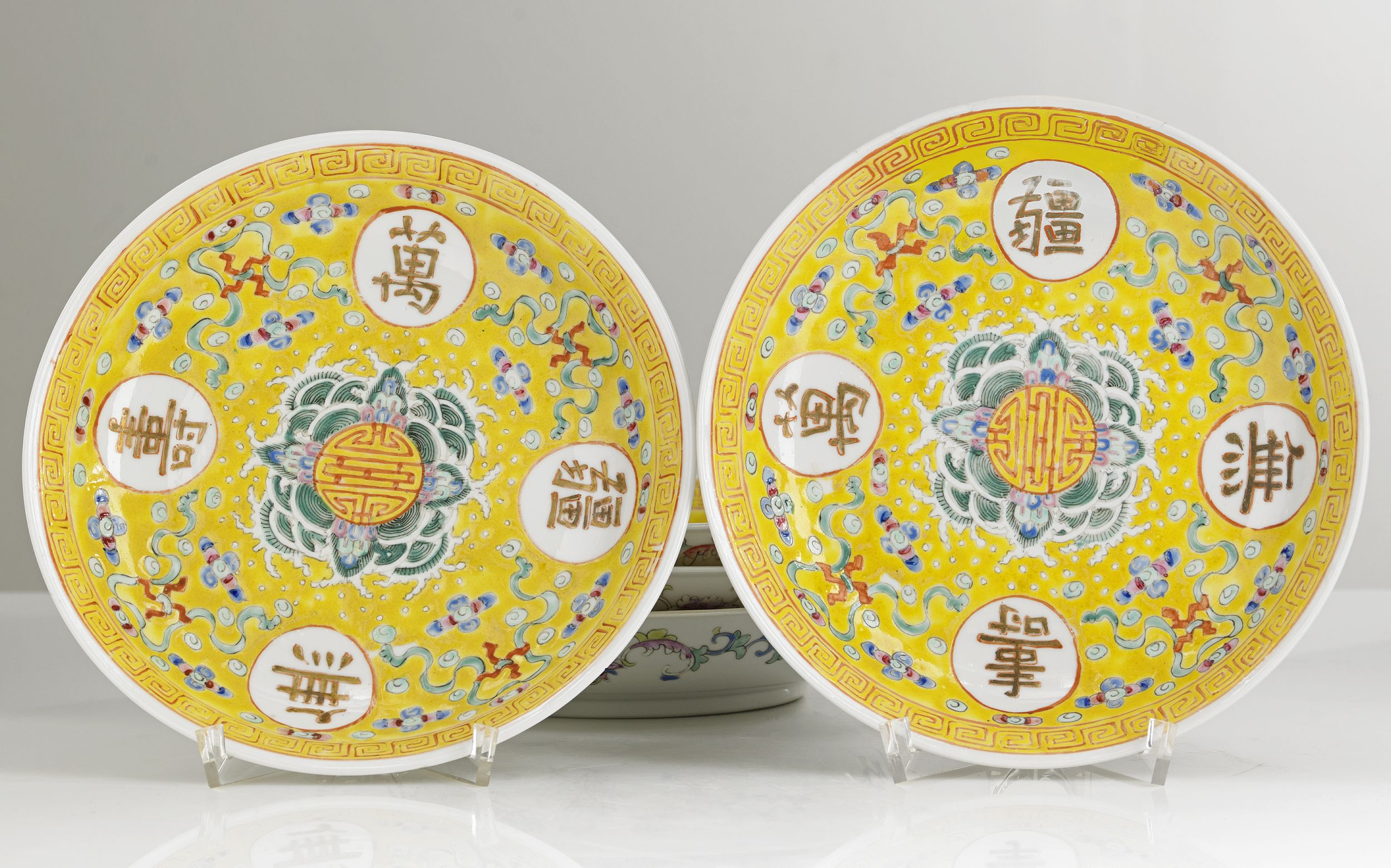 A Set of Seven Yellow-Ground Dishes