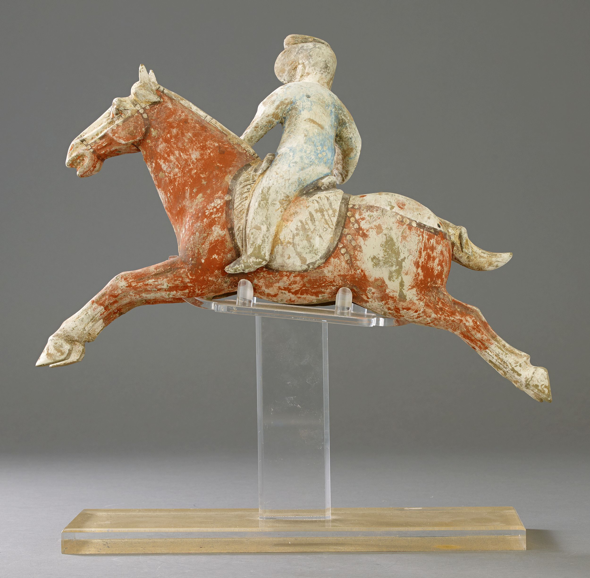 A Painted Pottery Female Polo Player