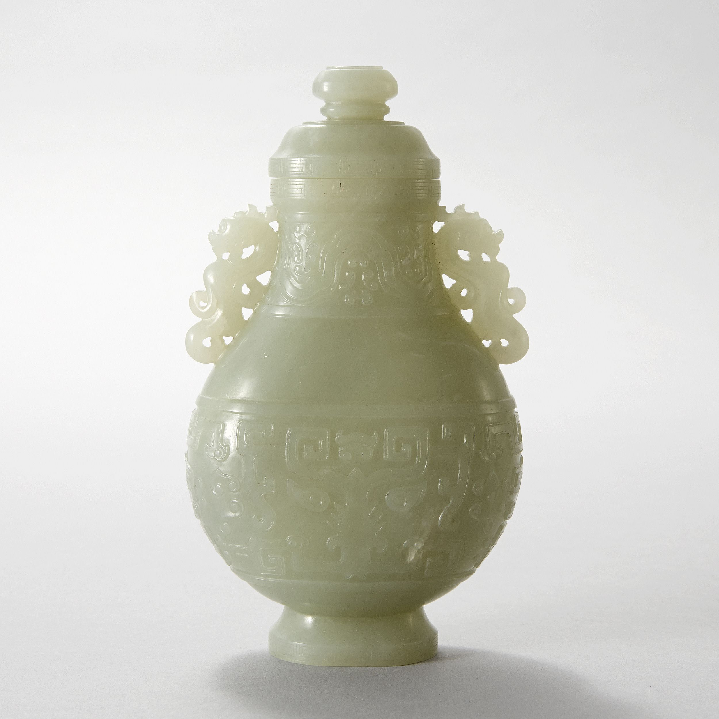 A Celadon Jade Vase and Cover