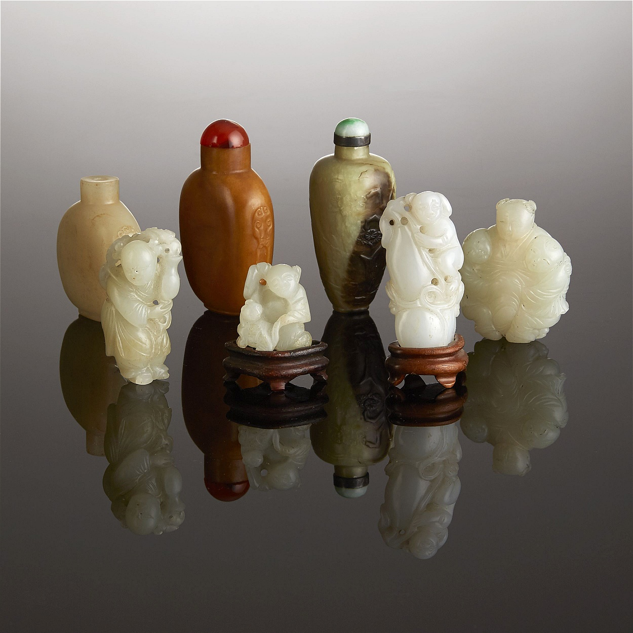 A Collection of Jade Carvings and Snuff Bottles