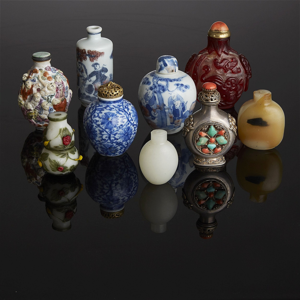 A Collection of Nine Snuff Bottles