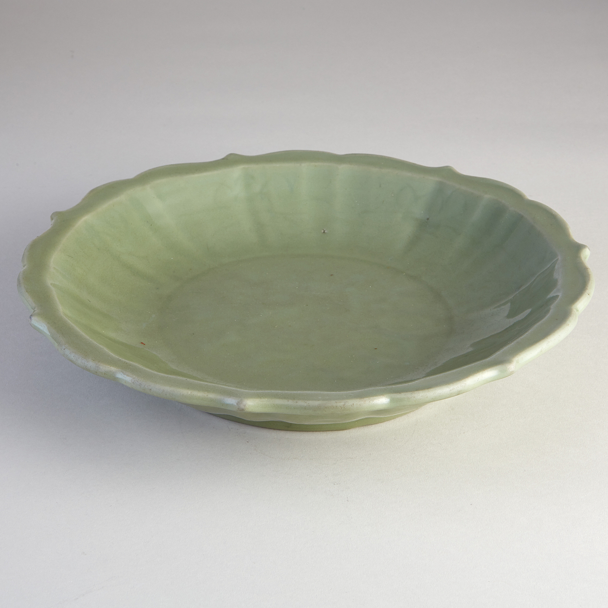 A Longquan Celadon Dish with Barbed Rim