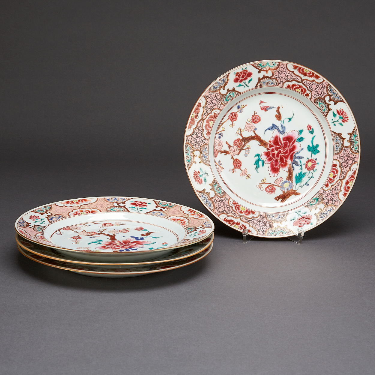 A Set of Four Famille Rose Plates