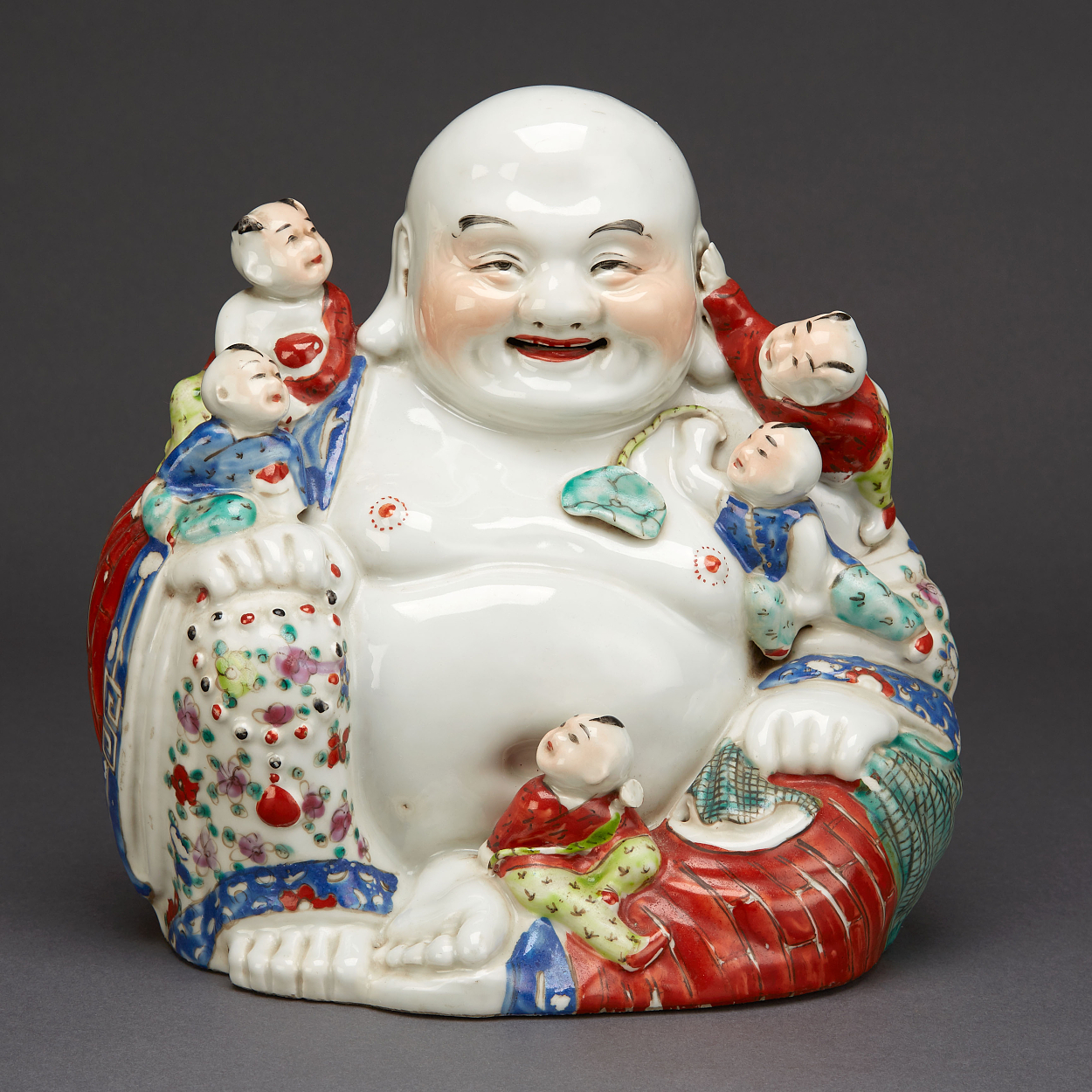 A 'Laughing Buddha' Figure with Children