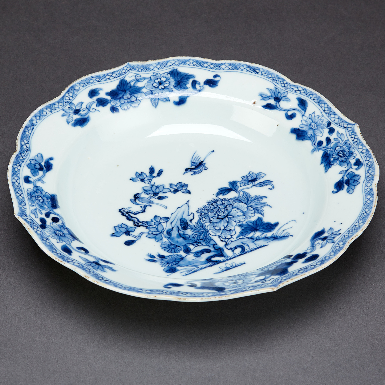 A Blue and White Plate and Two Dishes