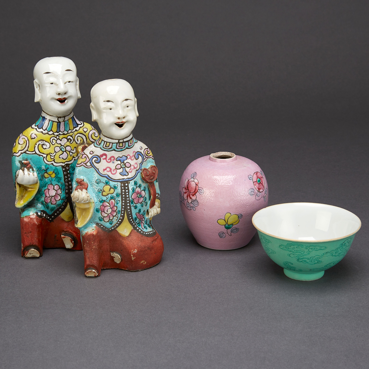 Two 'Laughing Boys', A Jar and A Cup