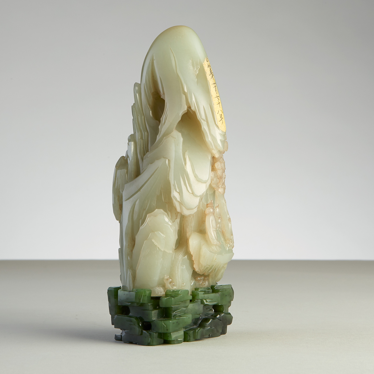 A Celadon Jade Boulder with Stand