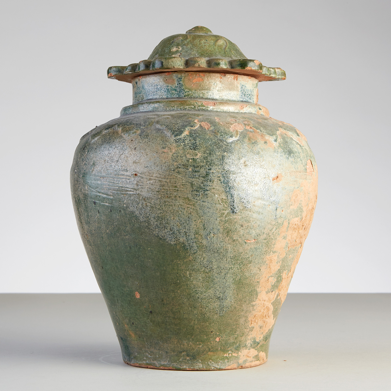 A Green Glazed Jar and Cover