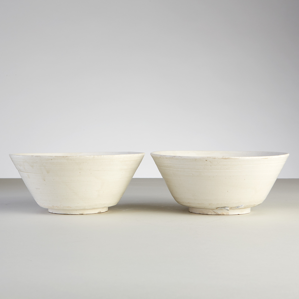 A Pair of White-Glazed Longquan Bowls
