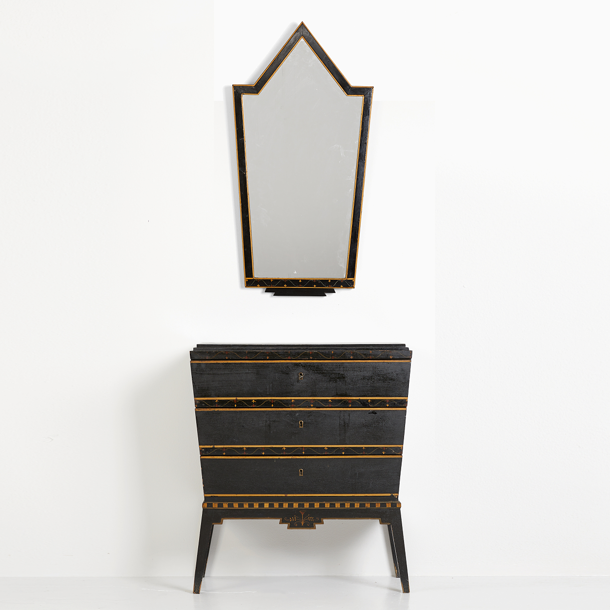 An Otto Schulz chest of drawers and a mirror