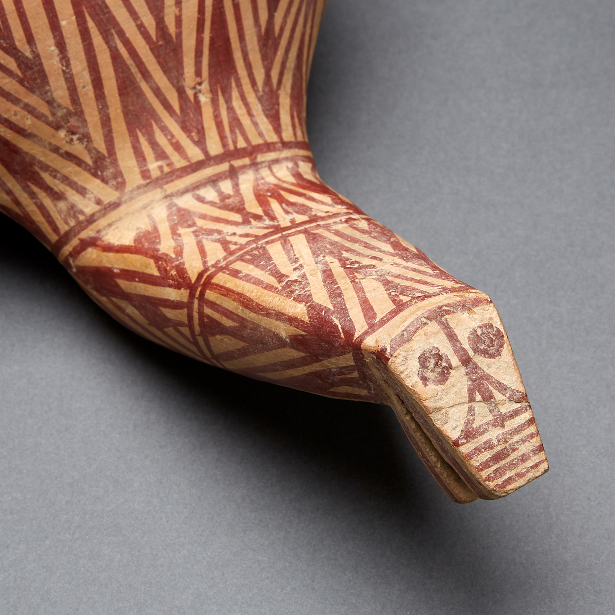 A Neolithic Painted Pottery Figure of a Bird