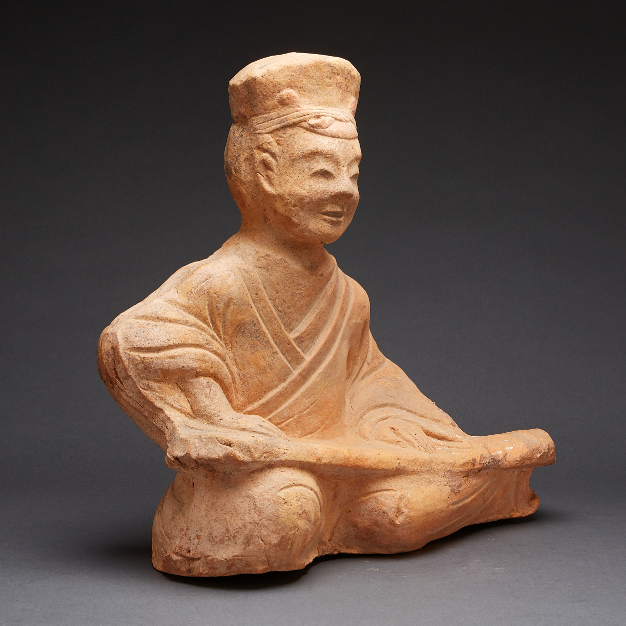 A Seated Pottery Musician