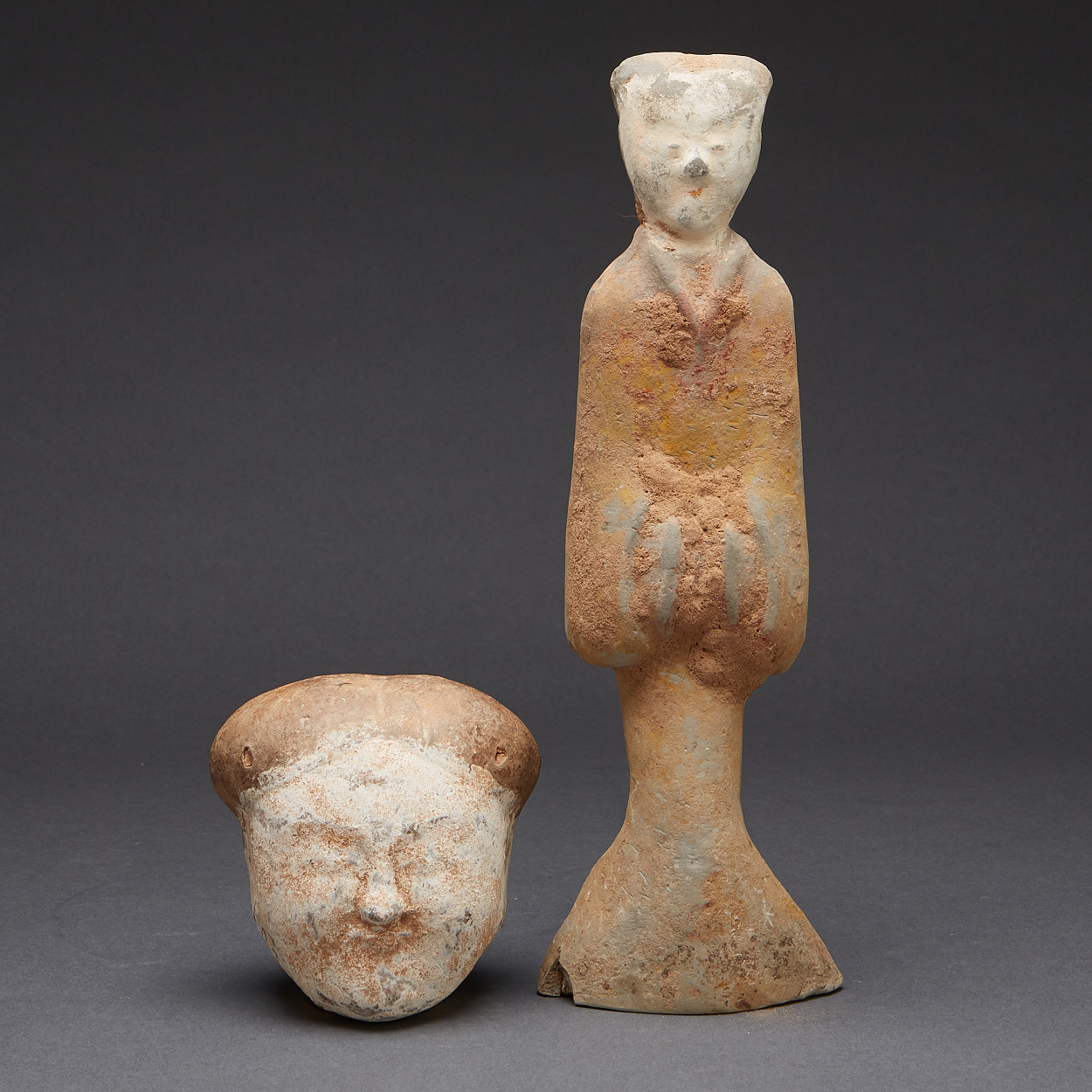 A Pottery Figure and A Head of a Court Lady