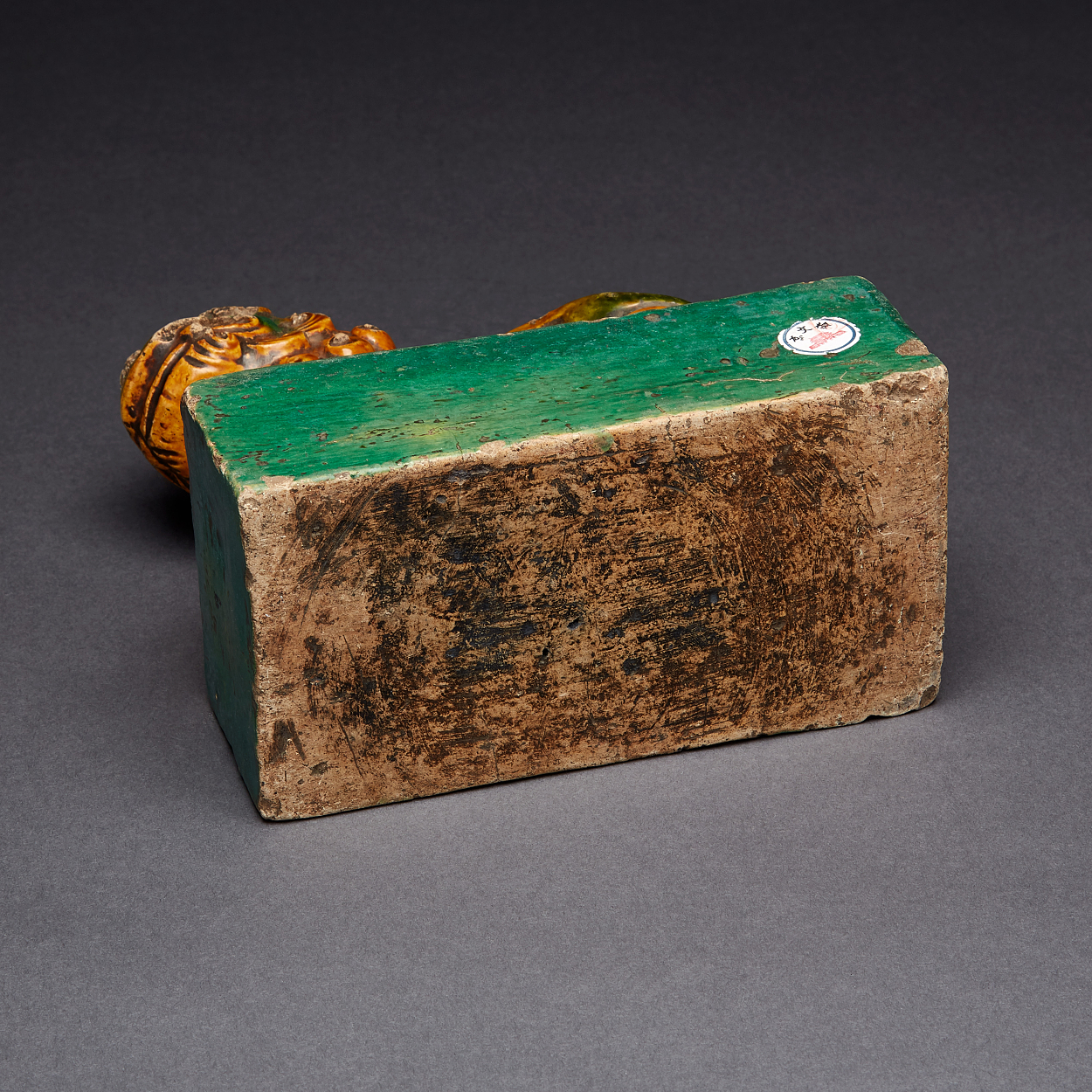 A Green and Yellow Glazed Brick with Fu Lion