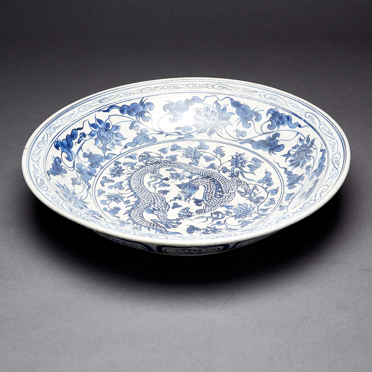 A Blue and White 'Dragon and Lotus' Charger