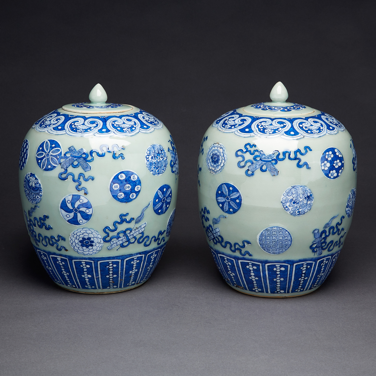 A Pair of Celadon Jars with Covers