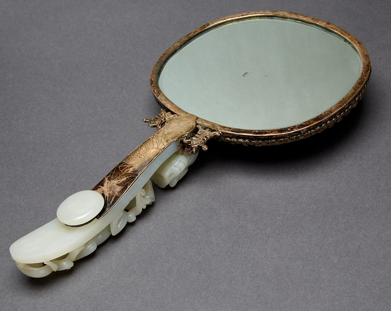 A Jade Mounted Hand Mirror